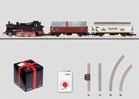 Geschenkset in kubusformaat. 230 volt. Goederentrein met railovaal en wandcontactdoosapparaat met passende traploze rijregelaar.