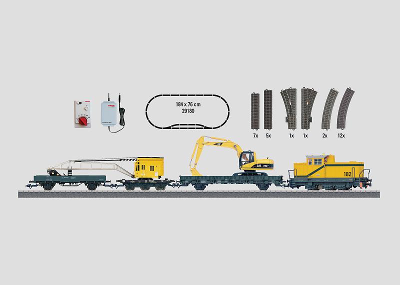 """Startpackung """"Baustelle"""": Diesellokomotive mit Baumaschinen-Zug, C-Gleis-Anlage und Digital-Fahrgerät."""